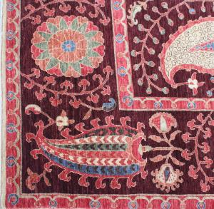 Suzani design with silk highlights woven 6x8.6